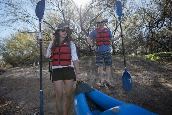 Two paddlers preparing to go kayaking