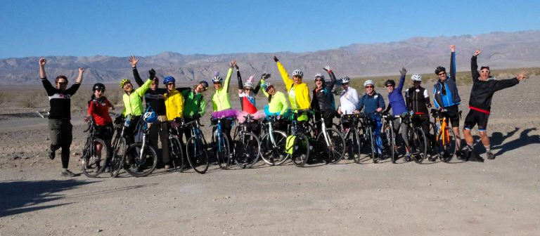 big group road cycling in death valley national park