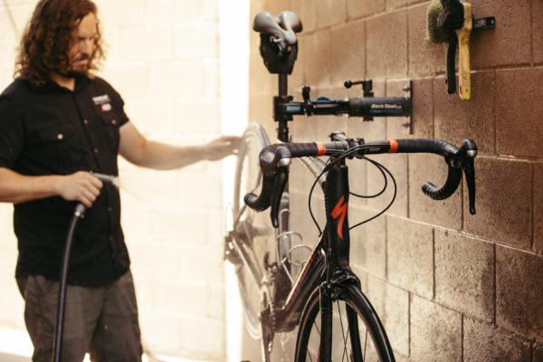 A bike mechanic working on a bicycle.