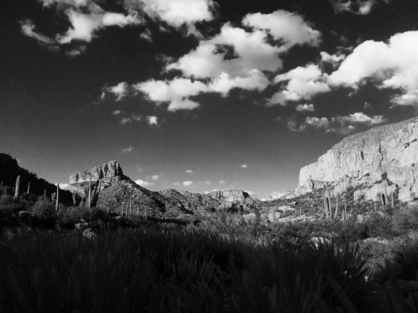 A black and white photo of the Superstition Mountains.