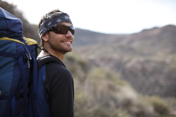 A male hiker smiling.