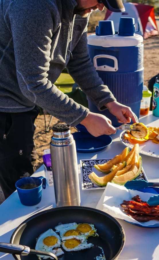 Cyclist prepares breakfast on Arizona mountain bike tour