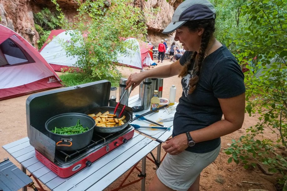 Camper cooks vegetables on Havasu Falls hiking trip