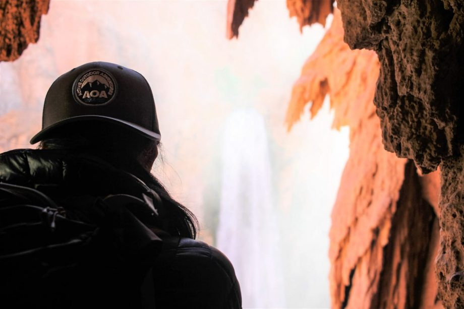 Back view of hiker in caves on Havasu Falls trip