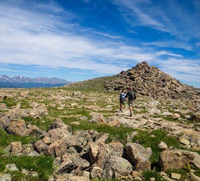 Hikers cross rocky field on Longs Peak trip