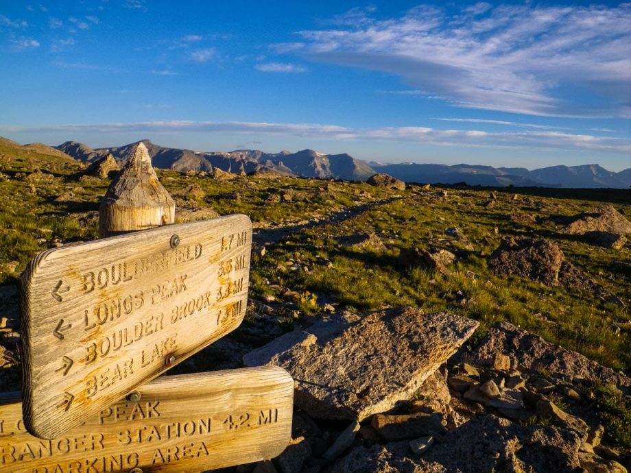 Longs Peak sign in front of Rocky Mountains