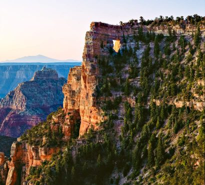 View of forested Grand Canyon walls from classic hiking trip
