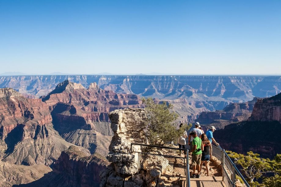 Hikers stand at Grand Canyon overlook view