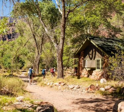 Hikers pass Grand Canyon Phantom Ranch cabin