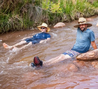 Hikers sit in stream on Grand Canyon Rim to Rim trip