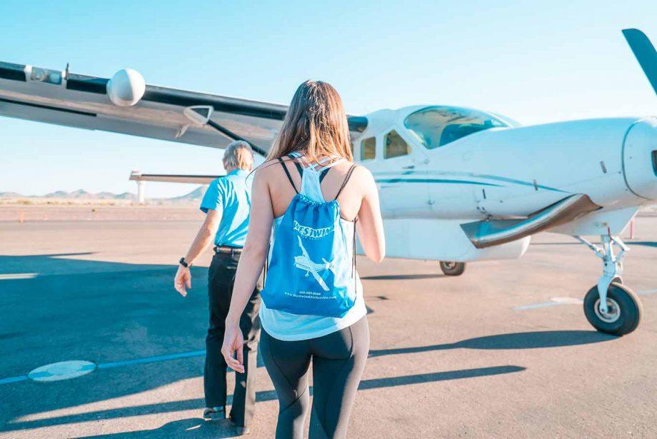 Passengers boarding a small aircraft