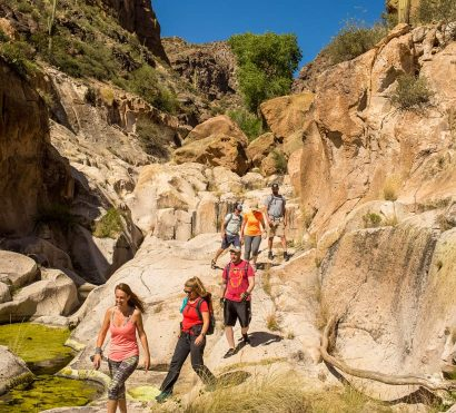 Hikers in Aravaipa Canyon on AOA backpacking tour