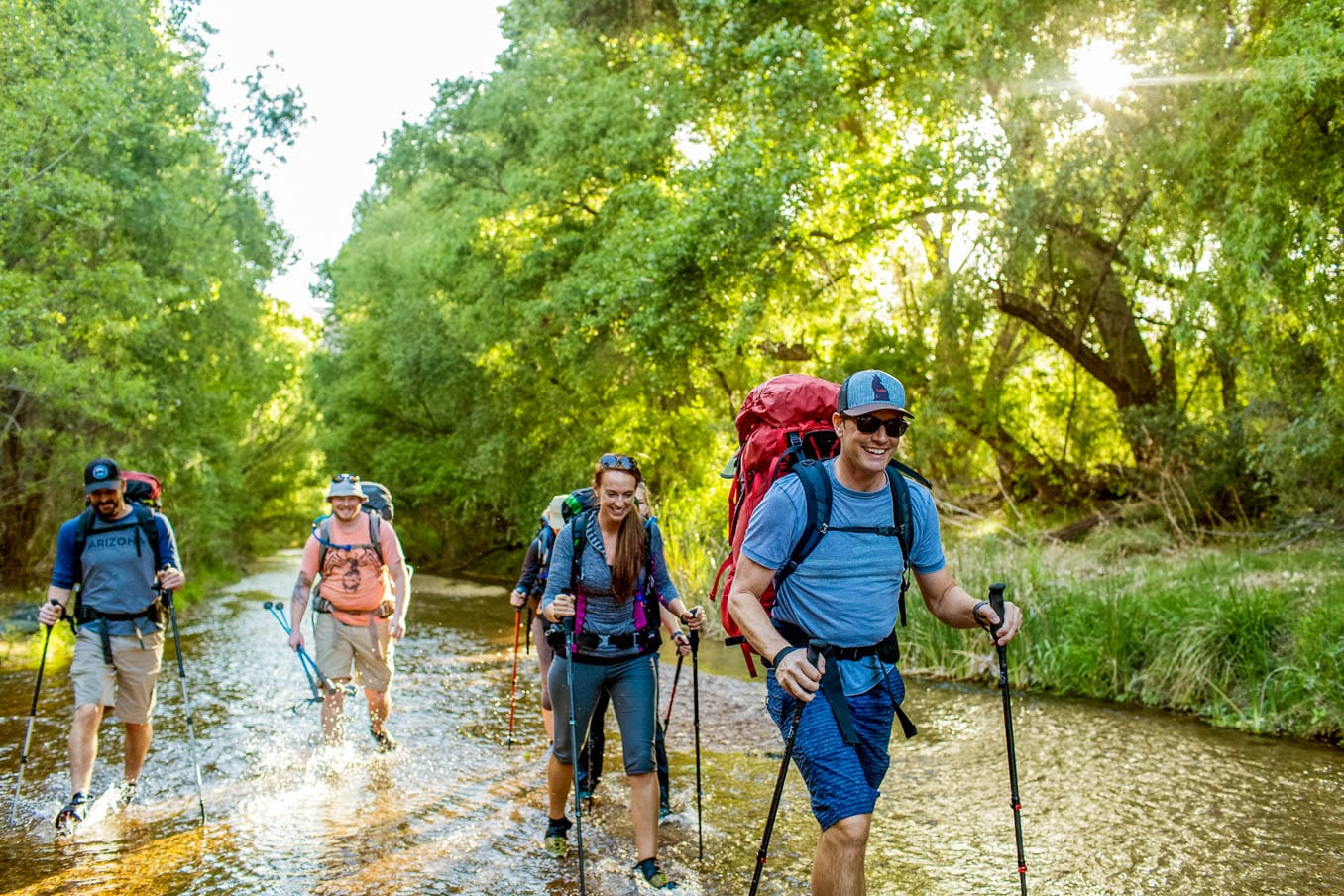 Hiking group wades through river on Aravaipa Canyon trip
