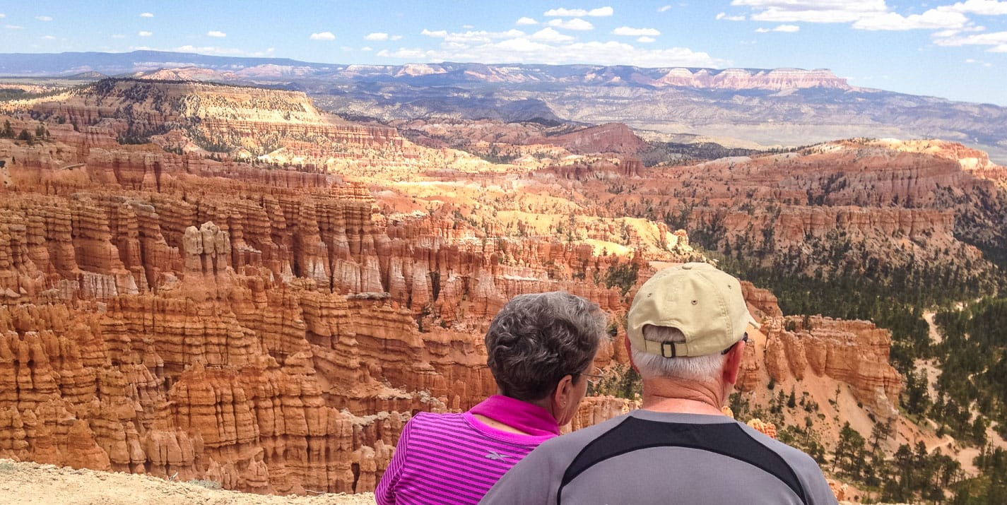 Couple sits on overlook at Bryce Canyon National Park.