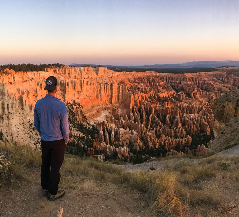 Hiker admires Bryce Canyon National Park view at sunrise