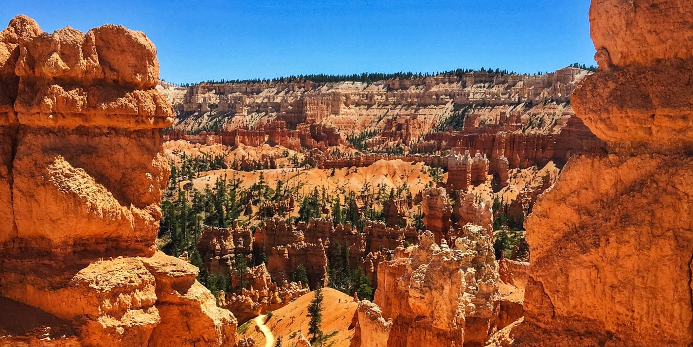 View of Bryce Canyon National Park between rock formations.
