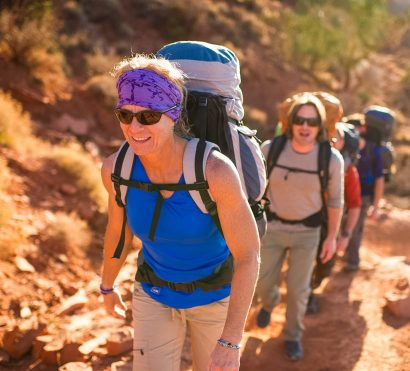 Hiking tour group climbs trail on Grand Canyon backpacking trip