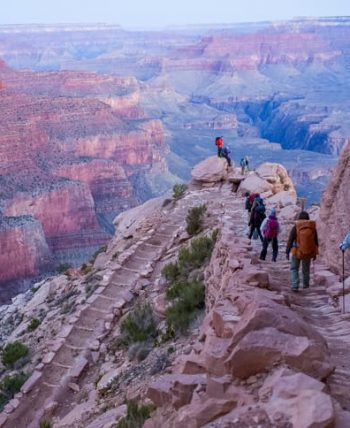 Hiking tour group descends into Grand Canyon on backpacking trip