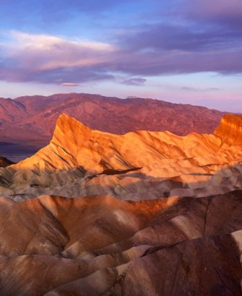 Sunset casts shadows over Death Valley landscape