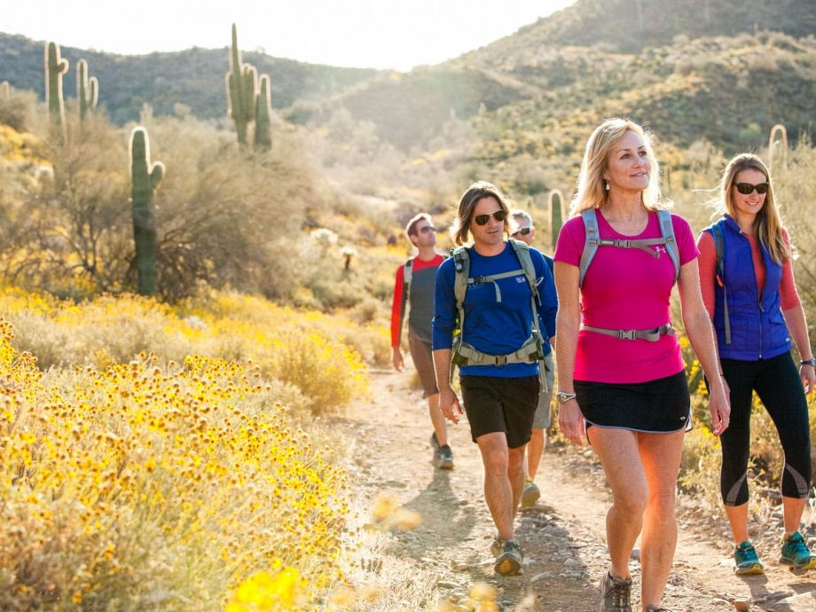Smiling hikers on Arizona desert trail adventure