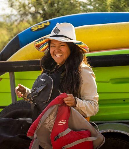 Smiling tour group member prepares for rafting adventure
