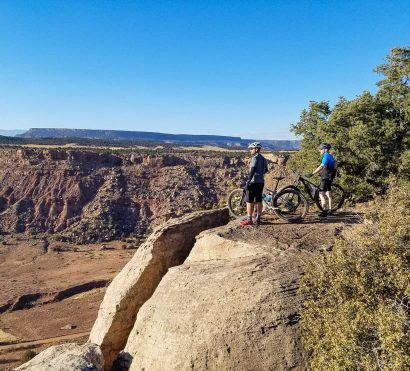 Mountain bikers overlook Utah canyon on Gooseberry Mesa tour