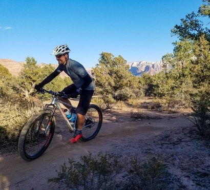 Mountain biker rides Gooseberry Mesa trail