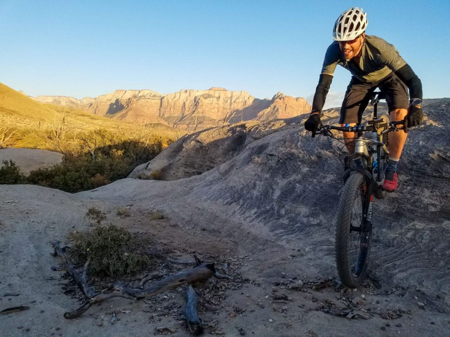 Excited mountain biker descends rocks on Gooseberry Mesa trail