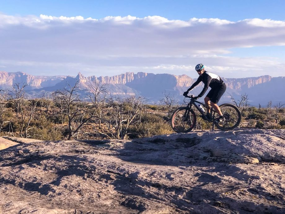 Mountain biker on rocks of Gooseberry Mesa trail