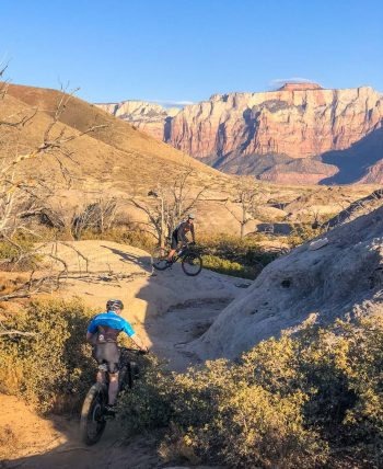 Mountain bikers on rocks of Gooseberry Mesa trail