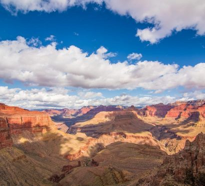 Fluffy clouds cast shadows on Grand Canyon valleys