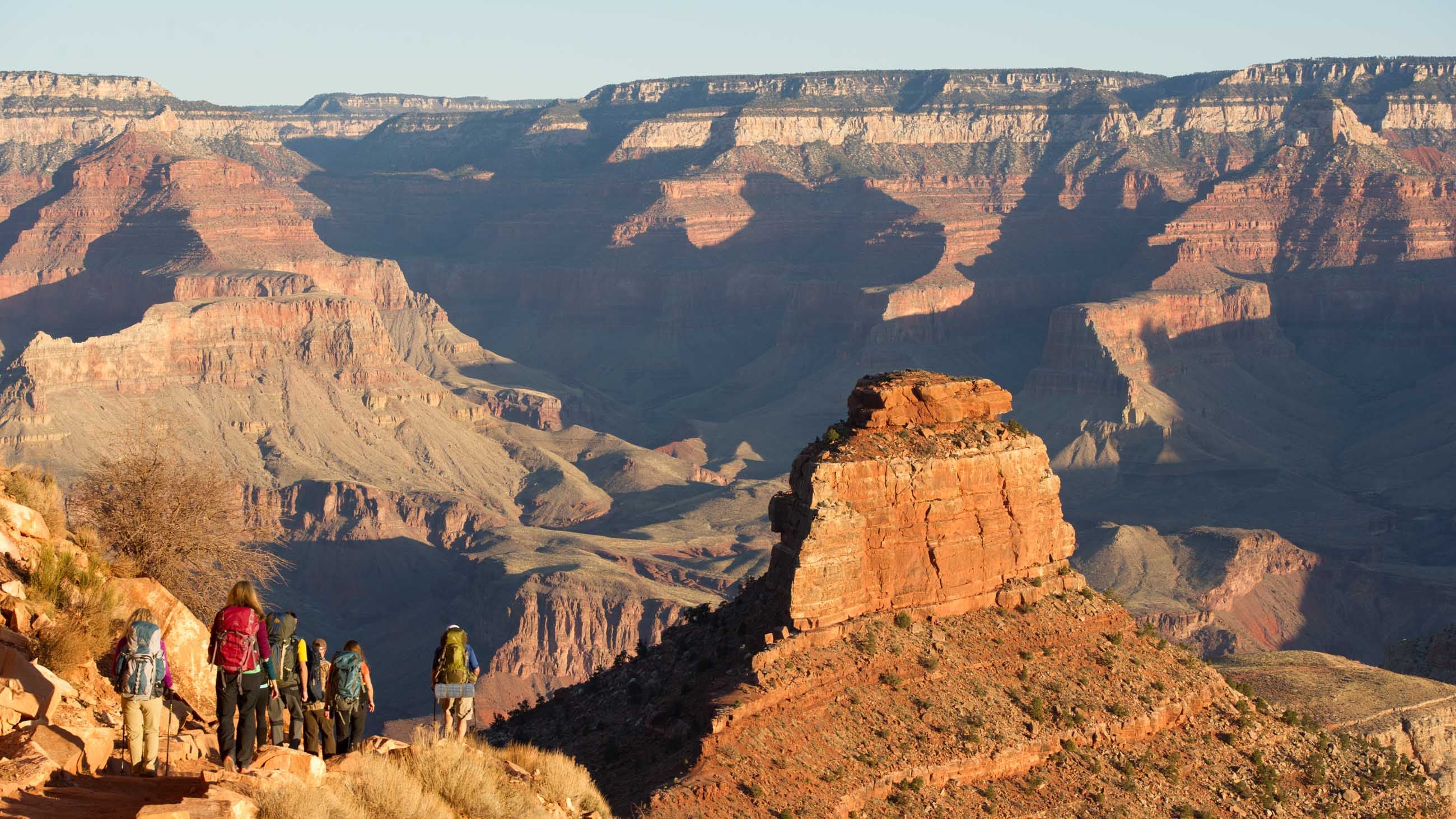 Hikers descend into Grand Canyon valley on backpacking trip