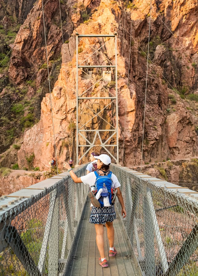 Hiking group crosses bridge on Grand Canyon Rim to Rim trip