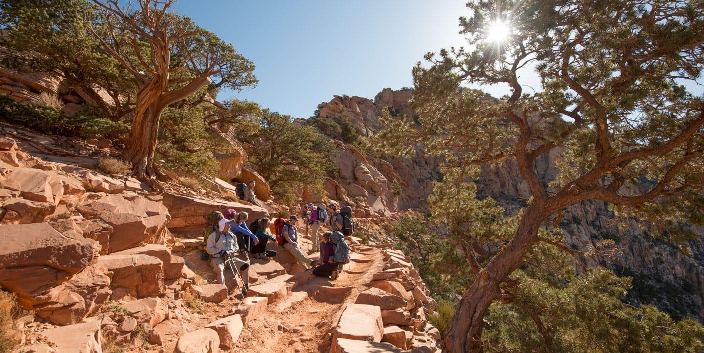 Hiking tour group takes a break on Grand Canyon trail.