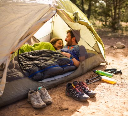 Campers settle into tent on Grand Canyon backpacking trip
