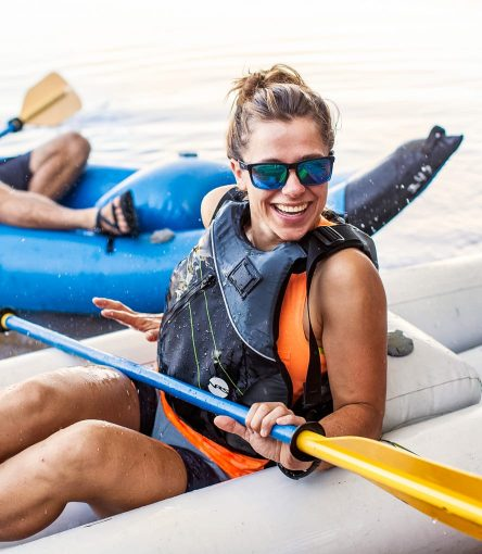 Smiling woman gets splashed on Saguaro Lake kayak tour