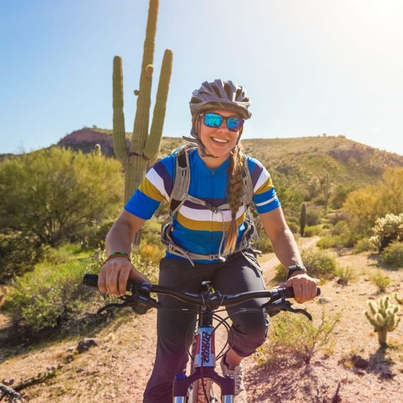Smiling cyclist on Scottsdale mountain bike day tour