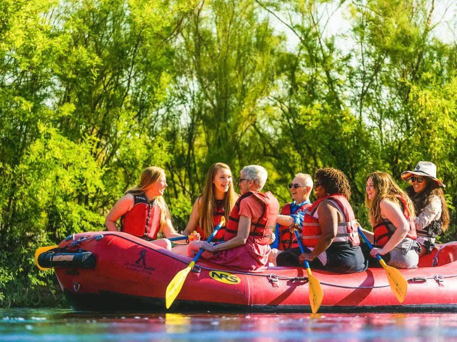 Laughing group enjoys Arizona rafting tour.