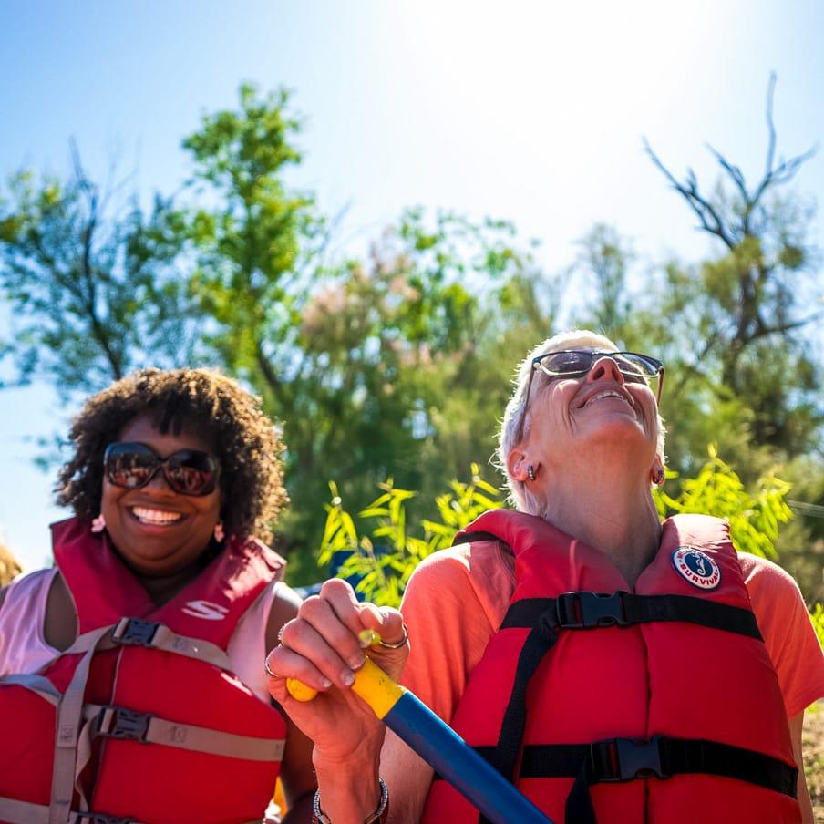 Smiling women on Arizona rafting tour