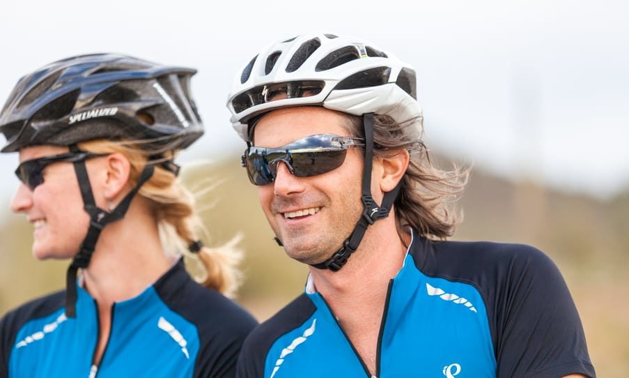 Smiling cyclists on Scottsdale road bike tour