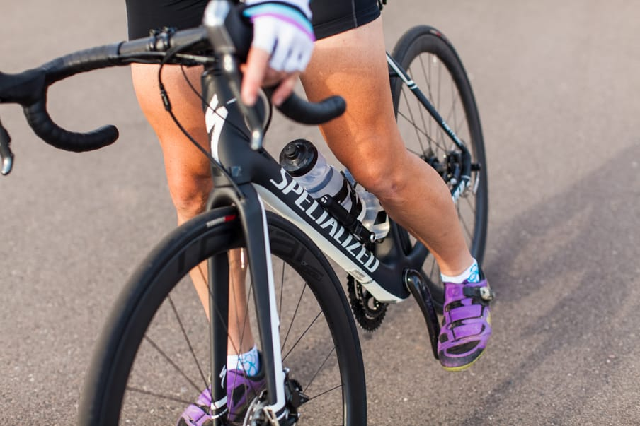Close up of road bike and cyclist's legs