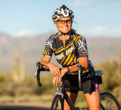 Smiling cyclist leans on handlebars on Scottsdale road bike tour