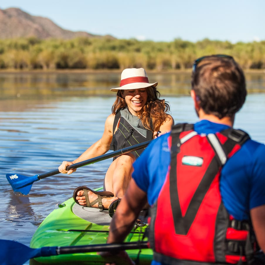 Stand up paddleboarders sit on boards on Saguaro Lake