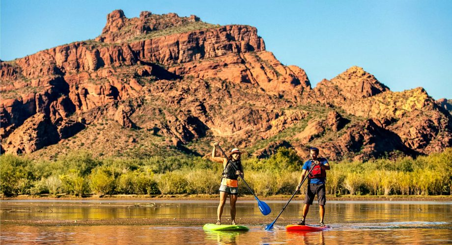 Stand up paddleboarding on on the Salt River with Red Mountain behind