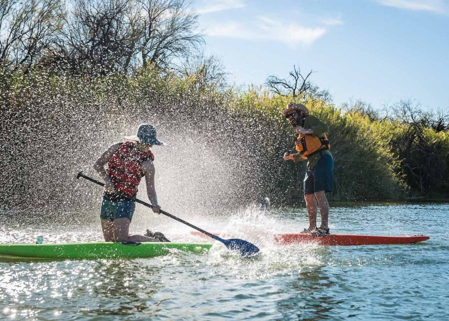 Stand up paddleboarders splash each other on Arizona tour