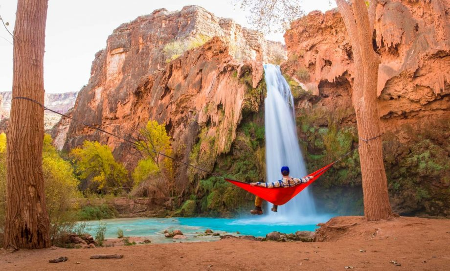 Hiker views Havasu Falls from hammock on backpacking trip