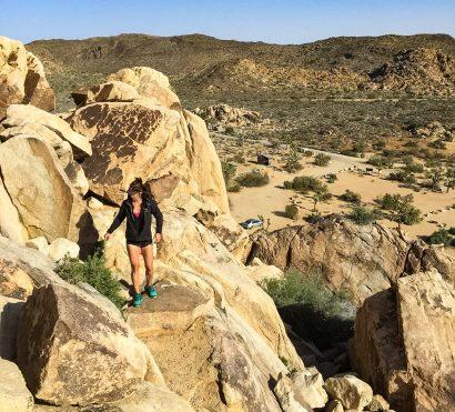 Hiker climbs rocks on Joshua Tree National Park trip