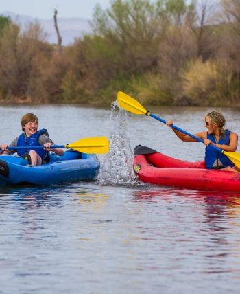 Woman splashes child on Lower Salt River kayaking tour