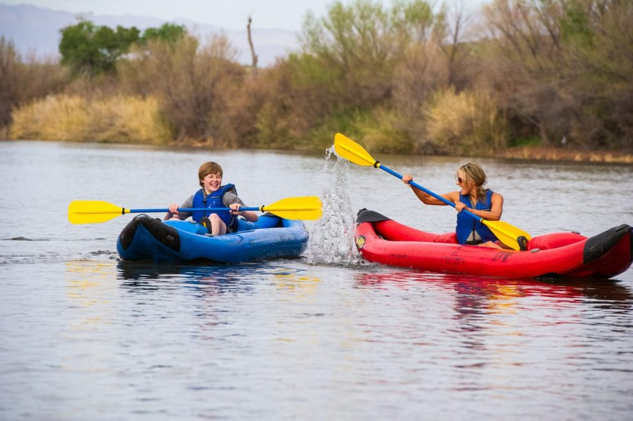 Woman splashes child on Lower Salt River kayaking tour
