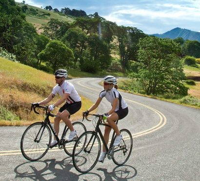 Cyclists bike California road on Napa self-guided tour